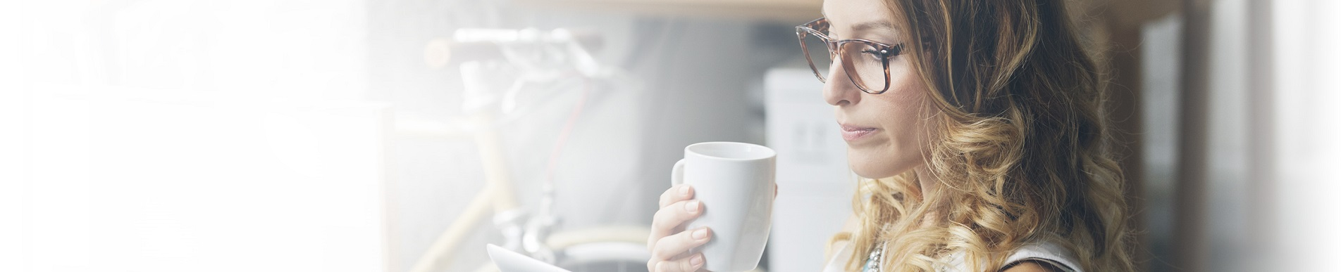 MOTRIN® helps woman enjoy drinking her coffee without headache pain