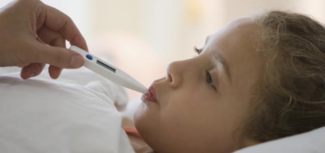 Checking a child's temperature
